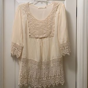 Cream blouse with lace bottom and sleeves